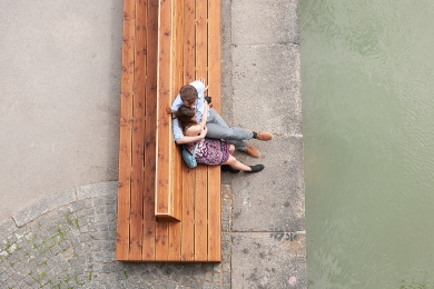 Lovers seating on a bench at Donau Kanal, Vienna.